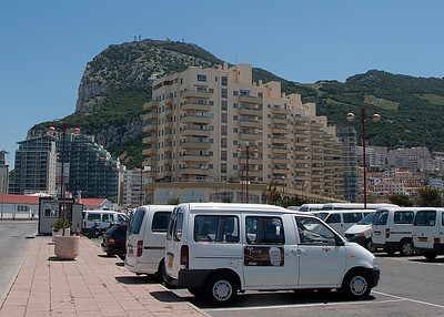 """Vans waiting to show tourists the """"rock"""""""