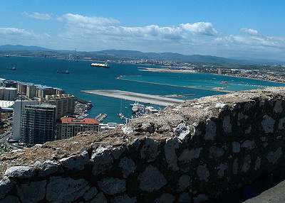 The airport runway extends across the main road into Gibraltar.