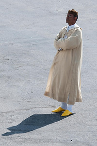 Tangiers - Guide waiting for customers.  We remember popularity of yellow shoes from our visit to Morroco in 2001