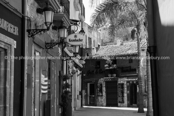 Narrow street leading to Plaza  San Antonio and Tumbao bar and grill, Denia Spain.