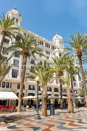 Street and architecture scene with wavy patterned tiled Explanada Promenade Alicante Spain