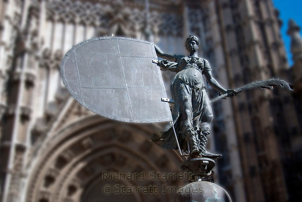 View of Seville's cathedral entrance.  This is a a copy of a windvane that sits atop the cathedral.
