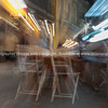 Abstract zoom blur night dining in back lanes Alicante Spain street and building scene