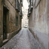 Typical residential street in Cadiz, Andalusia.  Note the wagon/chariot ruts in the cobbles. Late 1970's, Nikon F2, 50mm f/1.4 on Ektachrome 64.