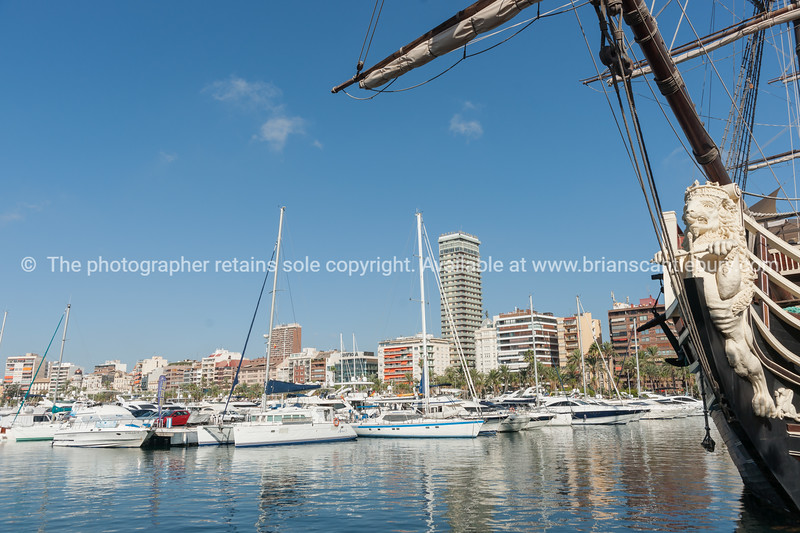 Marina and luxury boats with city skyline. Alicante, Spain