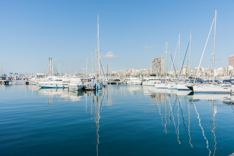 Marina and luxury boats with city skyline. Alicante, Spain