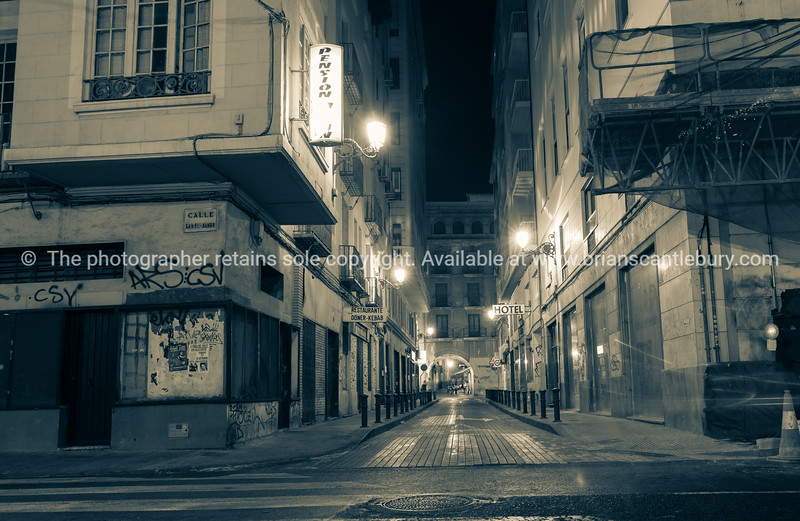 Alicante Spain gritty street and building scene at night long exposure