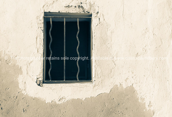 Window opening with bars in wall