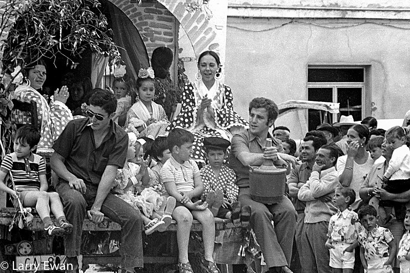 Parade float in Chipiona, Andalucia celebrating Nuestra Señora de Regla.  September 1980.  Notice the 4 liter wine jug.