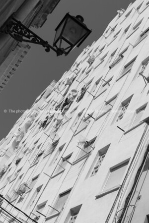 Low angle pointof view white multi story apartment building in Denia, Spain.