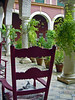 Grey cat sleeps in chair in Spanish Villa courtyard - Ecija - Spain