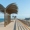 Sculptural palm trees on on the seaside esplanade at Muelle de Levante in the tourist resort elevated pedestrian walkway above breakwater, Alicante Spain