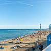 Barcelonetta Beach with architecturally modern W Hotel in distance, sunbathers along sandy beach Barcelona Spain