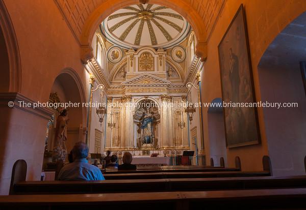 Ornate Catholic church in Alicante Spain street and building scene
