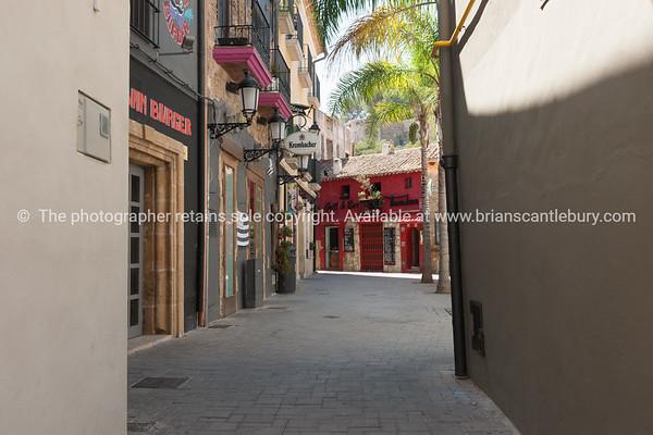 Narrow street leading to Plaza  San Antonio and Tumbao bar and grill, Denia Spain.