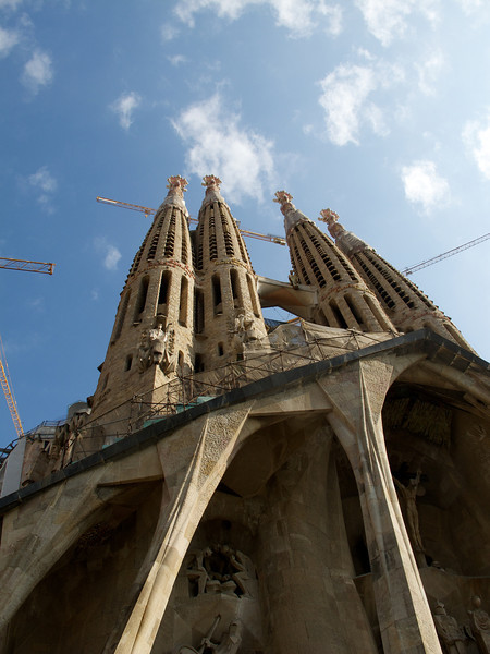 Gaudi's Sagrada Familia towers with construction cranes