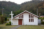 "A church on Chichijima Island, Ogasawara, Japan. The sign reads, ""Chapel of Peace. Dedicated to the military and civilian populace of the Bonin volcano islands by the United States Navy. AD  ..."