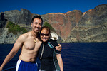 Tony Wu and Emiko Miyazaki in front of heart rock. Ogasawara Islands, Japan.