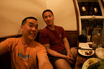 Underwater photographers Tony Wu and Eric Cheng at a restaurant in Ogasawara, Japan
