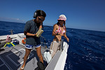 Tomoko Takahashi and crew member Shiho use a hydrophone to listen for sperm whales (Ogasawara Islands, Japan)