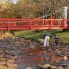 USA-Sperryville-VA-A father and son attempt to cross a stream by the Glassworks Gallery