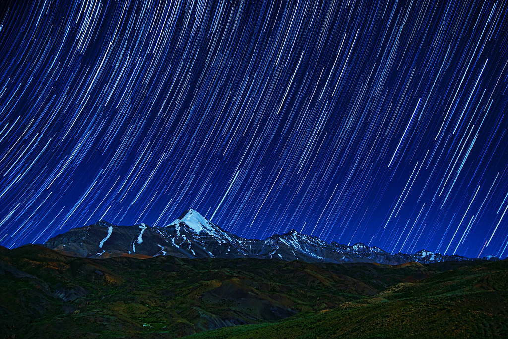The stars rain down on 'Chau Chau Kang Nilgam' peak in the himalayas. A 45-minute exposure to get the stars moving!