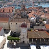 Clock tower at city square and view of Trogir, Croatia.