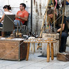 Local vendor selling souvenir and wares at the Port of Split in Croatia.