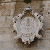 Image molded on a building wall in Trogir, Croatia.