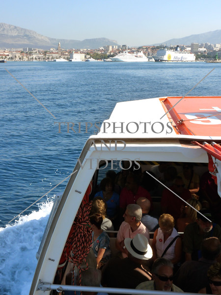 A cruise ship tender boat approaches the port of Split, Croatia.