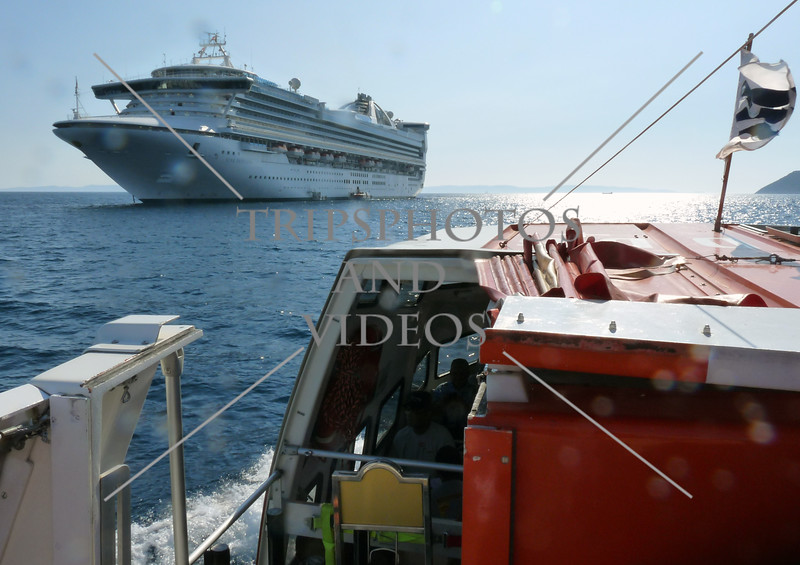 Tender boat approaches the cruise ship anchored off the Port of Split in Croatia.