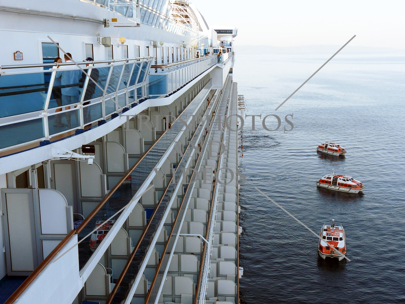 Side view of the cruise ship and boats getting ready to tender passengers to the port of Split, Croatia.