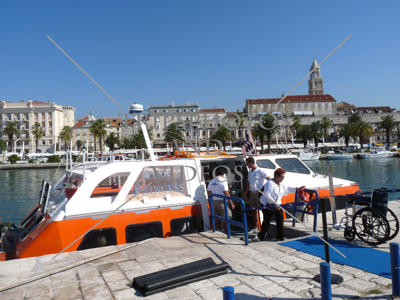 Cruise ship passengers disembarking off the tender boat at the port of Split, Croatia.