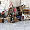 Local vendor selling souvenirs and wares at the Port of Split in Croatia.