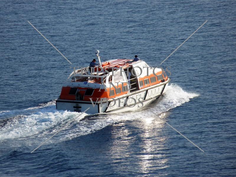 A cruise ship tender boat heading to the port of Split, Croatia.
