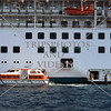 Anchored cruise ship and tender boat loading passengers off the Port of Split in Croatia.