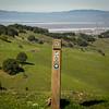 Weathered Bay Area Ridge Trail signpost