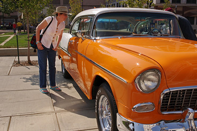 Rita checks out a Chevy 1955 or '56, Classic Car Show, downtown Springfield, Missouri, 8/11/2012