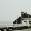 Squantum Yacht Club at high tide during a storm.
