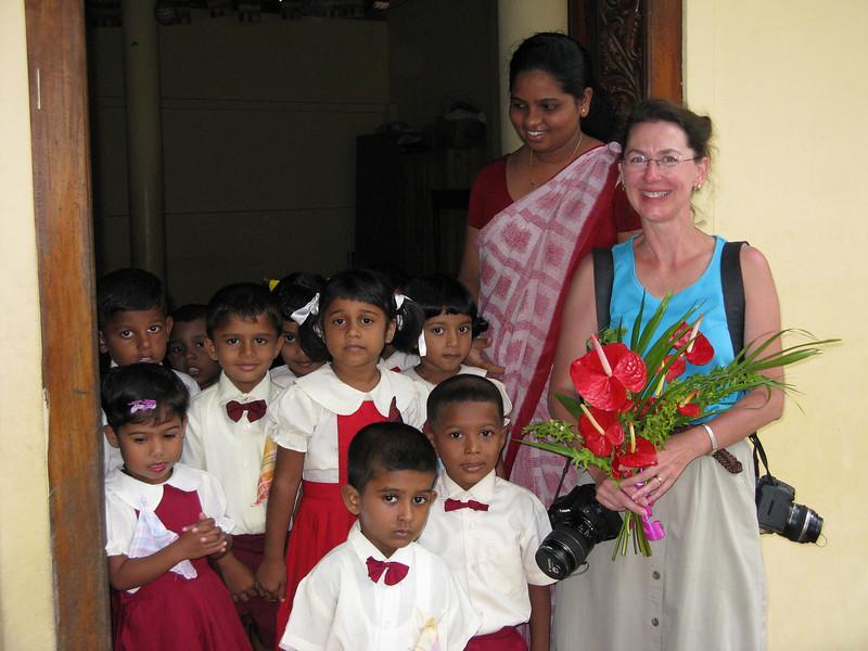 Children and teacher greet Jeane at Montessori school in Kalutara