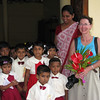 Children and teacher greet Jeane at Montessori school in Kalutara