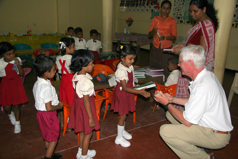 Craig hands out supplies to the school children