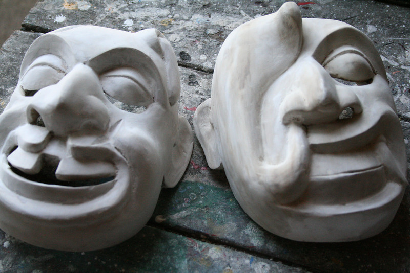 The mask on the right is said to depict a headache leaving your head.  Wow!