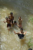 Big Splash<br /> <br /> Clean potable water and water for hygenic purpose is the need of the hour. Children in Sri Lanka splashing in water and having fun while taking their bath as well as washing their cloths in a stream passing adjacent to the road. This stream also serves as a waste outlet. Location: Near Colombo, Sri Lanka.