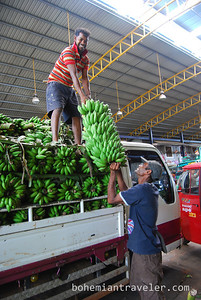 Men unload bananas at Dambulla wholesale market in Sri Lanka.