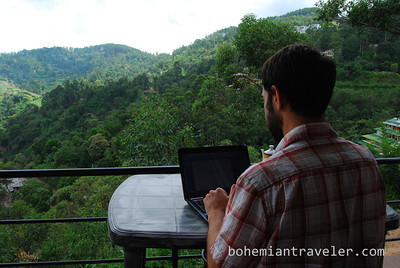 Stephen working online from our guesthouse.