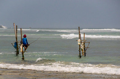 Traditional stilt fishermen who no longer fish but just pose for tourist photos.
