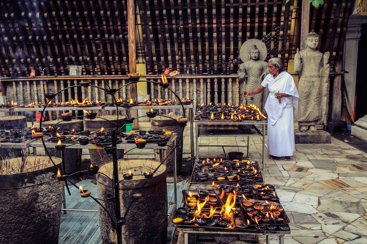 'Devotee in a buddhist temple' - Taken at the Gangaramaya Temple in Colombo.