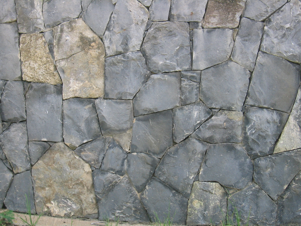 Stone work. Our understanding is that the island government hired a number of Portugese stone masons to work on walls for the highways.