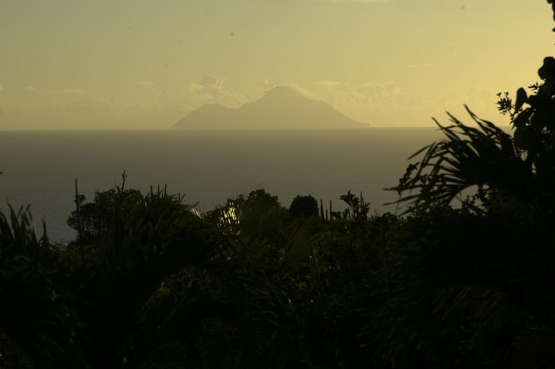 Saba in the golden haze of sunset from our front deck at Ker Roch Glaz.